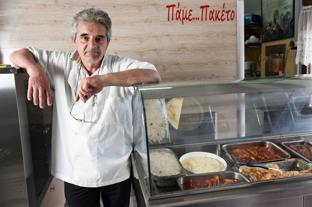 """Dionyssis Hastoukis 55, owner of  """"Pame Paketo""""  take away restaurant that uses the TEM (local alternative currency).  One of the meals he offers daily is sold inTEMs and he offers the rest of the meals on TEMs after 16:30"""