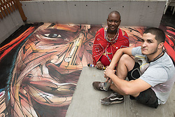 November 10, 2016 - Hong Kong, Hong Kong S.A.R, China - Rooftop painting by Parisian street artist Alexandre Monteiro aka Hopare (R) of Masai warrior Daniel Ole Sambu (L).Street art in Hong Kong ahead of the The √íHope for Wildlife√ì Gala Dinner painted to raise awareness for the plight of endangered animals the world over..Sheung Wan Hong Kong.10th November 2016. Photo by Jayne Russell. (Credit Image: © Jayne Russell via ZUMA Wire)