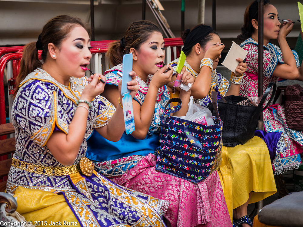"04 SEPTEMBER 2015 - BANGKOK, THAILAND:  Dancers get ready to perform for a special ceremony at the Erawan Shrine. A ""Holy Religious Ceremony for Wellness and Prosperity of our Nation and Thai People"" was held Friday morning at Erawan Shrine. The ceremony was to regain confidence of the Thai people and foreign visitors, to preserve Thai religious customs and traditions and to promote peace and happiness inThailand. Repairs to Erawan Shrine were completed Thursday, Sept 3 after the shrine was bombed on August 17. Twenty people were killed in the bombing and more than 100 injured. The statue of the Four Faced Brahma in the shrine was damaged by shrapnel and a building at the shrine was damaged by debris.    PHOTO BY JACK KURTZ"