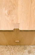 Handmade oak wood furniture. Close up on the dovetail joint