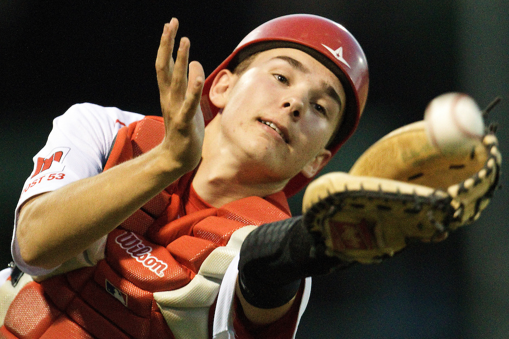 Home Federal catcher Phoenix Stevenson nearly grabs a foul ball in Tuesday's game against Hastings at Ryder Park. Hastings won 3-2. (Independent/Matt Dixon)