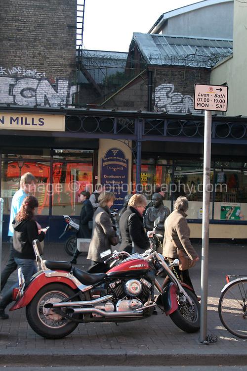 Motorbike parked on footbath in Dublin city centre Ireland