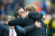 Huddersfield Town Manager David Wagner (l) and Liverpool Manager Jurgen Klopp embrace prior to kick off. Premier League match, Liverpool v Huddersfield Town at the Anfield stadium in Liverpool, Merseyside on Saturday 28th October 2017.<br /> pic by Chris Stading, Andrew Orchard sports photography.