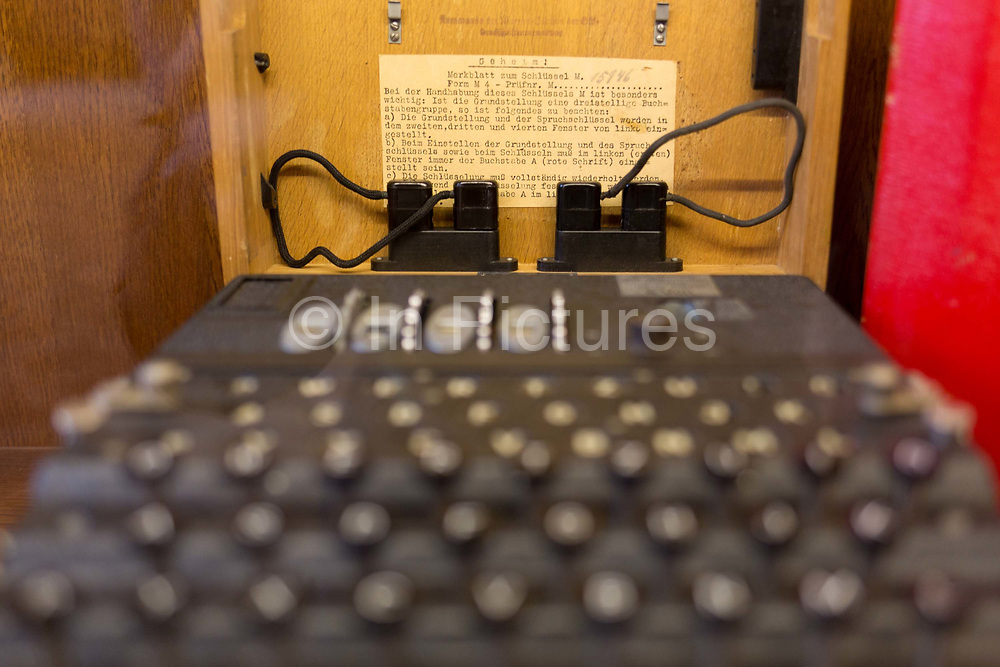 A WW2-era German secret Enigma code machine is displayed in the Locarno Dining Room, in the Foreign and Commonwealth Office FCO, on 17th September 2017, in Whitehall, London, England. The Enigma machine is a piece of hardware invented by a German and used by Britains codebreakers as a way of deciphering German signals traffic during World War Two. It has been claimed that as a result of the information gained through this device, hostilities between Germany and the Allied forces were curtailed by two years. An estimated 100,000 Enigma machines were constructed.