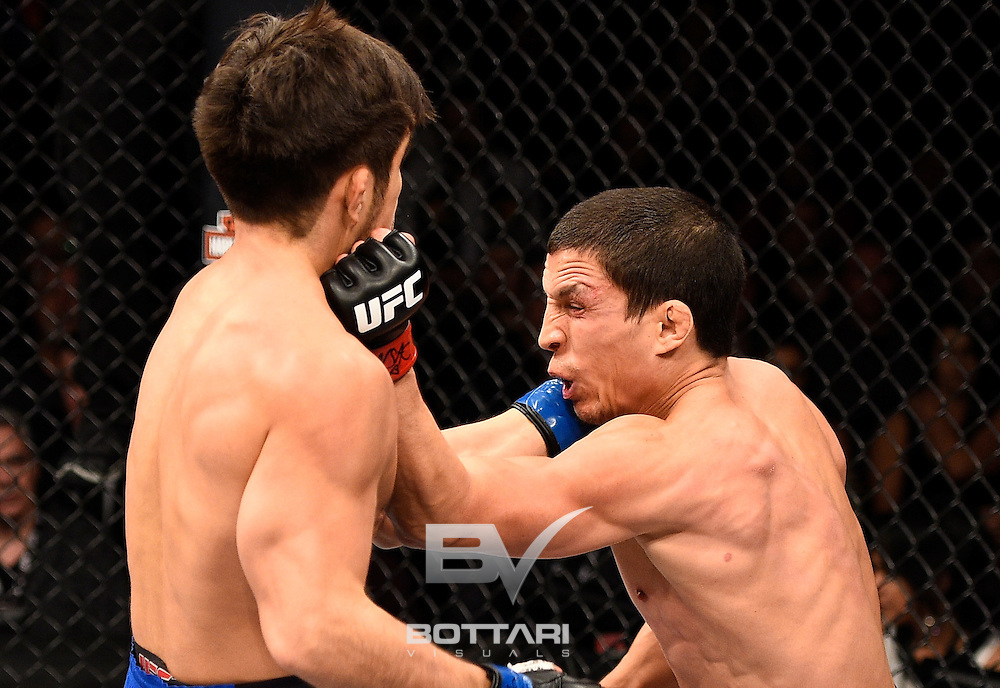 LAS VEGAS, NV - DECEMBER 03:  (R-L) Joseph Benavidez punches Henry Cejudo in their flyweight bout during The Ultimate Fighter Finale event inside the Pearl concert theater at the Palms Resort & Casino on December 3, 2016 in Las Vegas, Nevada. (Photo by Jeff Bottari/Zuffa LLC/Zuffa LLC via Getty Images)
