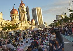 June 3, 2017 - Kuala Lumpur, Kuala Lumpur, Malaysia - People wait for their Iftar (breaking fast) meals at Merdeka Square during the holy month of Ramadan, (Credit Image: © Kepy via ZUMA Wire)