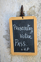 Covid Pass Sanitaire (Covid Passport) sign outside restaurant, Southern France, 2021