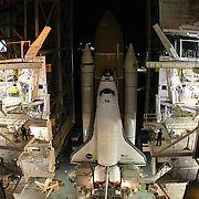 Space shuttle Endeavour sits in the Vehicle Assembly Building prior to it's move to launch pad 39A at the Kennedy Space Center in Cape Canaveral, Fla., on Thursday, March 10, 2011.  (AP Photo/Alex Menendez)