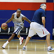 Turkish Basketball team Anadolu Efes's Tarence Kinsey (L) during their new season training at Anadolu Efes sports hall in Istanbul Turkey on Monday 22 August 2011. Photo by TURKPIX