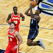 ORLANDO, FL - MARCH 03: Dwayne Bacon #8 of the Orlando Magic pulls up for a shot in front of Danilo Gallinari #8 of the Atlanta Hawks and Tony Snell #19 of the Atlanta Hawks during the first half at Amway Center on March 3, 2021 in Orlando, Florida. NOTE TO USER: User expressly acknowledges and agrees that, by downloading and or using this photograph, User is consenting to the terms and conditions of the Getty Images License Agreement. (Photo by Alex Menendez/Getty Images)*** Local Caption *** Dwayne Bacon; Danilo Gallinari; Tony Snell