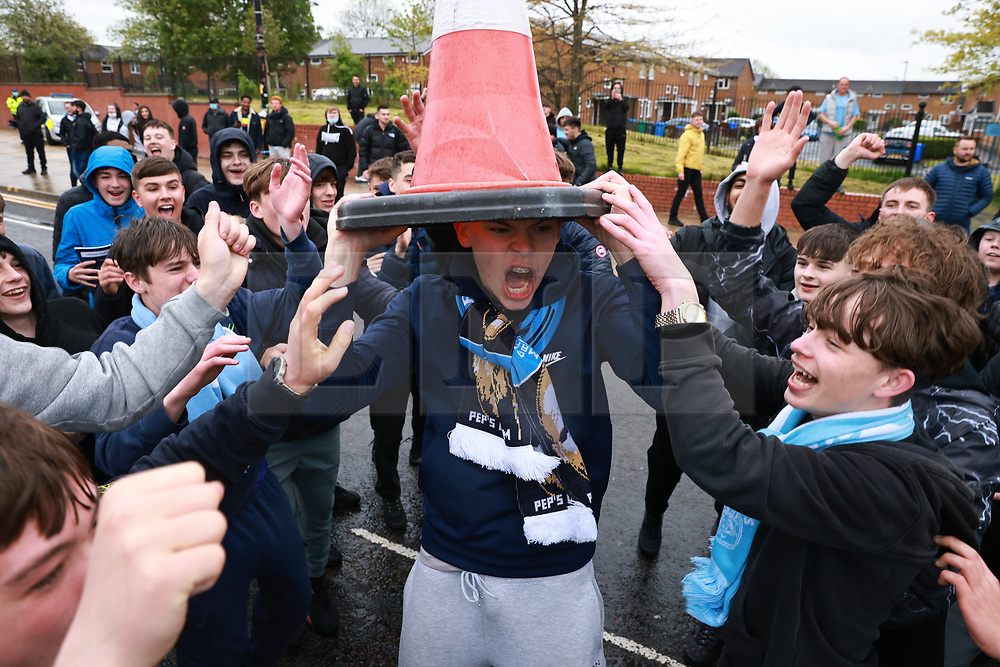 © Licensed to London News Pictures. 23/05/2021. Manchester, UK. Fans outside the stadium as the match ends. Manchester City fans are expected to celebrate outside the Etihad Stadium after their team beats Everton at home, having secured the Premiership title previously . Photo credit: Joel Goodman/LNP