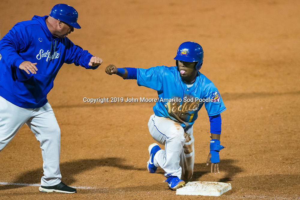 Amarillo Sod Poodles outfielder Rodrigo Orozco (1) fist bumps Manager Phillip Wellman against the Midland RockHounds on Thursday, May 23, 2019, at HODGETOWN in Amarillo, Texas. [Photo by John Moore/Amarillo Sod Poodles]
