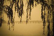 Winter Palace Seventeen-Arch Bridge to Nanhu Island located in Kunming Lake, Beijing, China