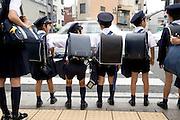 elementary school children waiting to cross the street Kyoto Japan