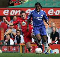 Photo: Paul Thomas.<br />Blackburn Rovers v Chelsea. The FA Cup, Semi Final. 15/04/2007.<br /><br />Didier Drogba (Blue) of Chelsea is tackled by Brett Emerton.