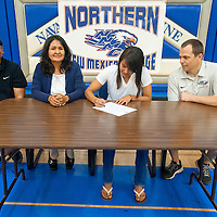060613       Brian Leddy<br /> Demetria Clichee, in white, is surrounded by her parents Mel Clichee and Beverly Hardy as well as Northern New Mexico College women's basketball coach Jack Ballard.  Clichee, who played for Navajo Pine, signed a letter of intent to play basketball with the school.