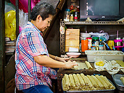 31 JULY 2018 - BANGKOK, THAILAND:  Women make fish sausage in a workshop in their home in Bangkok's Chinatown district. It is one of the largest Chinatowns in the world. It was established in 1781 when Siamese King Rama I gave the Chinese community in Bangkok land outside of Bangkok's city walls so he could build his palace (what is now known as the Grand Palace). Chinatown is now the heart of the Thai-Chinese community. About 14% of Thais have Chinese ancestry.   PHOTO BY JACK KURTZ