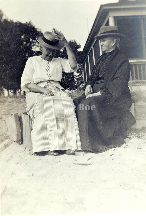 two happy elderly women sitting outside