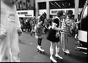 St Patrick's Day Parade.1982.17/03/1982.03.17.1982.Skaters hitch a lift while a lion looks on.