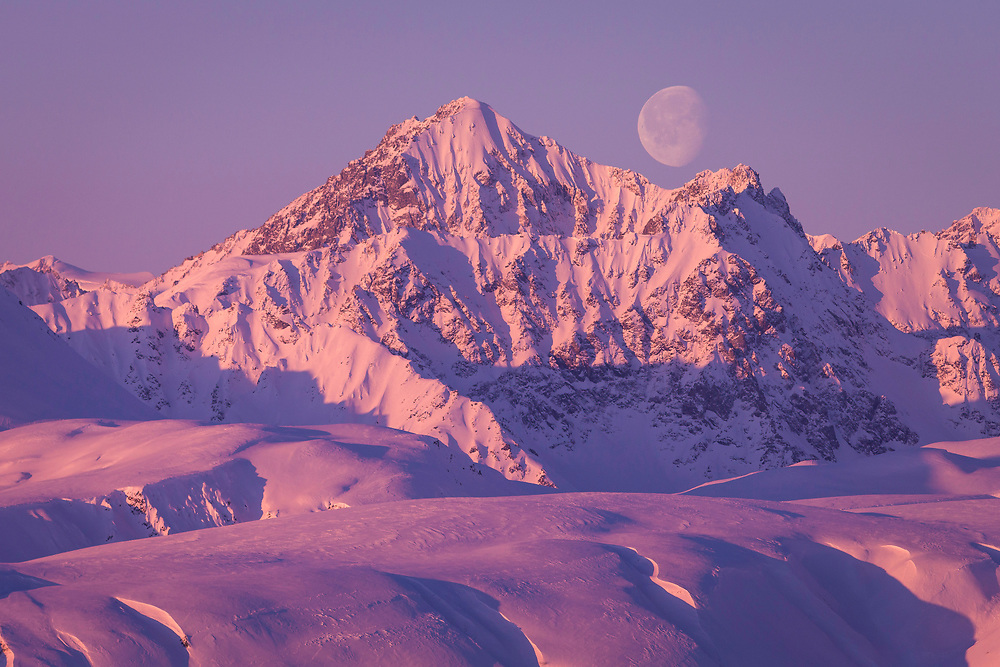 I shot this image of the moon rising over the Tordrillo Mountains during the making of The Art of Flight movie. As we lifted off in the helicopter and climbed to about 300 feet, I asked the pilot to slow down for a minute so that I could open the door and take this photo. <br /> <br /> <br /> <br /> Early morning moon rise over some spectacular lines just minutes from our lodge.