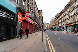 Glasgow, Scotland, UK. 6 Mar 2021. With Scotland remaining under national lockdown during the covid-19 pandemic Glasgow city centre remains a virtual ghost town with few people in the city centre and almost all shops and businesses still closed.  Pic; Normally busy Union Street is empty and most shops are closed and shuttered. Iain Masterton/Alamy Live News