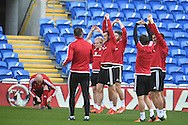 Gareth Bale of Wales © and his teammates stretch  during Wales football team training session at the Cardiff city stadium  in Cardiff, South Wales  on Monday 12th October 2015. The team are training ahead of their final Euro 2016 qualifying against Andorra tomorrow.<br /> pic by  Andrew Orchard, Andrew Orchard sports photography.