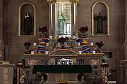 Altar of the Templo de Nuestra Señora del Sagrario church decorated for the Day of the Dead festival in Santa Clara del Cobre, Michoacan, Mexico.