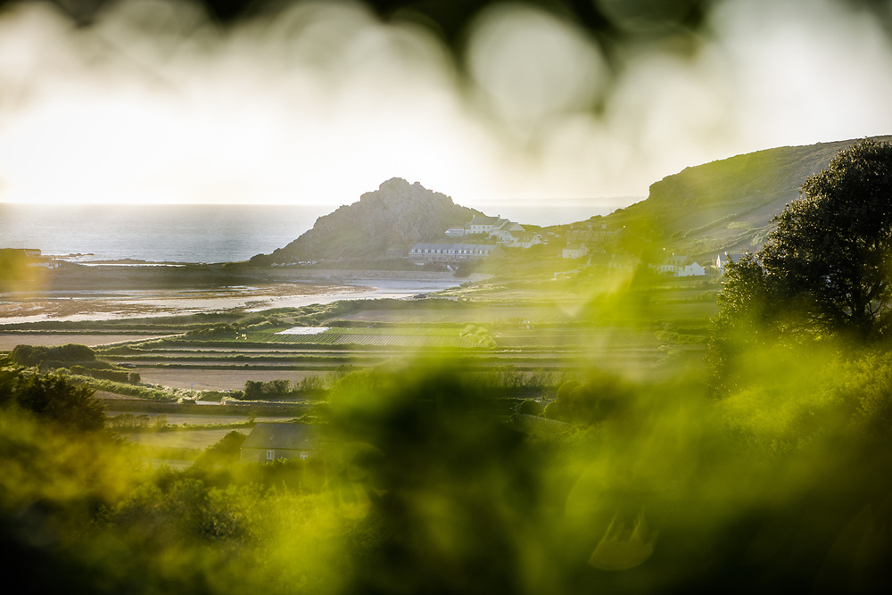View of the sea at L'Etacq along St ouen's Bay from up on the Grantez hillside in Jersey, CI