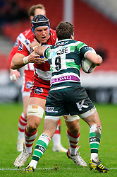London Irish Scrum-Half (#9) Darren Allinson hands off Gloucester Lock (#4) Will James during the first half of the match - Photo mandatory by-line: Rogan Thomson/JMP - Tel: Mobile: 07966 386802 15/12/2012 - SPORT - RUGBY - Kingsholm Stadium - Gloucester. Gloucester Rugby v London Irish - Amlin Challenge Cup Round 4.