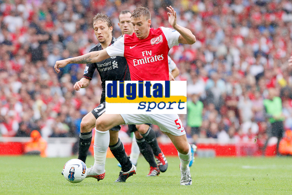 Football - Premiership - Arsenal vs. Liverpool<br /> <br /> Arsenal's Nicklas Bendtner and Liverpool's Lucas Leiva in action at The Emirates Stadium