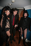 Lord Johnson Somerset and Nicky Haslam, Andy and Patti Wong's Chinese New Year of the Pig party. Madame Tussauds. ( Dress Burlesque, Debauched or Hollywood Black Tie. ) London. 27 January 2007.  -DO NOT ARCHIVE-© Copyright Photograph by Dafydd Jones. 248 Clapham Rd. London SW9 0PZ. Tel 0207 820 0771. www.dafjones.com.