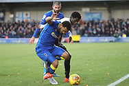 AFC Wimbledon striker Andy Barcham (17) battles for possession with Peterborough United midfielder Leo Da Silva Lopes (18) during the EFL Sky Bet League 1 match between AFC Wimbledon and Peterborough United at the Cherry Red Records Stadium, Kingston, England on 12 November 2017. Photo by Matthew Redman.