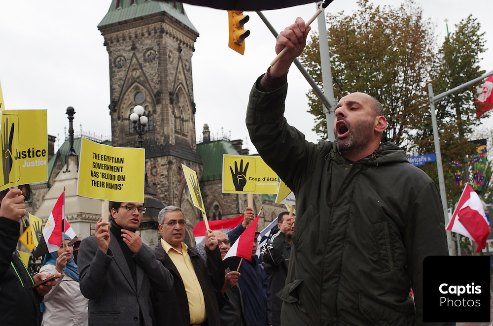 Pro-Morsi protestors demonstrate in front of Parliament Hill in Ottawa against Morsi's ousting by the military.