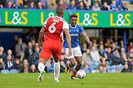 Portsmouth Forward, Jamal Lowe (18) and Fleetwood Town Defender, Nathan Pond (6) during the EFL Sky Bet League 1 match between Portsmouth and Fleetwood Town at Fratton Park, Portsmouth, England on 16 September 2017. Photo by Adam Rivers.