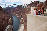 Visitors at Hoover Dam, with Mike O'Callaghan - Pat Tillman Memorial Bridge in the distance, Mojave Desert, AZ