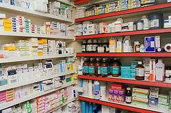 Shelves of medicines in chemist shop,
