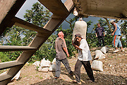 24 OCTOBER 2003 -- TAPACHULA, CHIAPAS, MEX: Workers on a coffee plantation near Tapachula, Mexico, load a truck with harvested coffee. The plantation, like many in the area, relies on undocumented workers from Guatemala. World coffee prices have been depressed by over production in Brazil and Vietnam and thousands of coffee farmers in Mexico and Guatemala have been forced to emigrate to the US as undocumented workers because of the crisis in the coffee industry. PHOTO BY JACK KURTZ