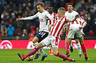 Christian Eriksen of Tottenham Hotspur (L) is tackled by Ryan Shawcross of Stoke City (R). Premier league match, Tottenham Hotspur v Stoke City at Wembley Stadium in London on Saturday 9th December 2017.<br /> pic by Steffan Bowen, Andrew Orchard sports photography.