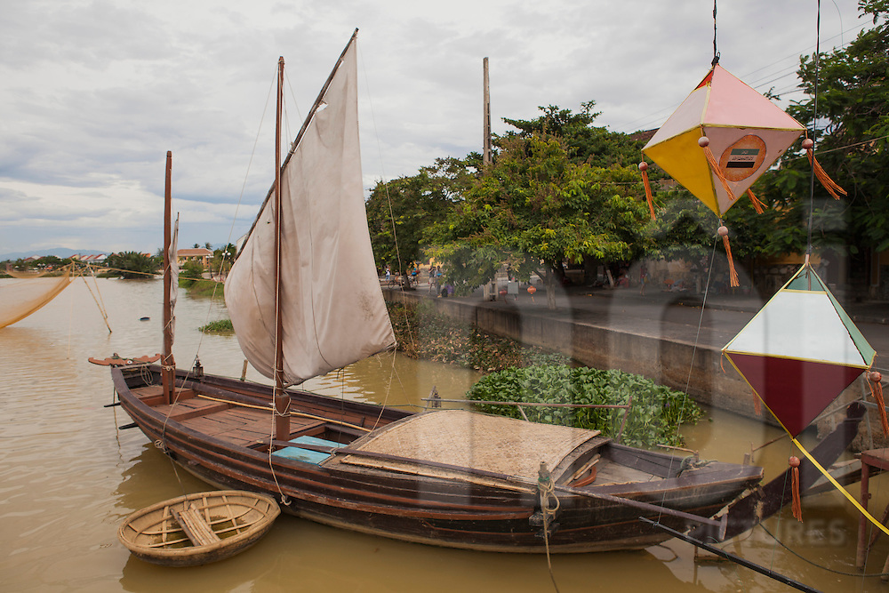 Wooden boat moored along Thu Bon River in Hoi An, Vietnam, Asia