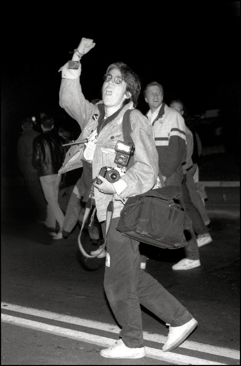 Ellen Neipris, an Impact Visuals photographer, covering an anti-violence march in New York City in 1989.
