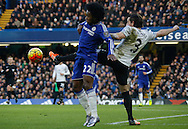 Chelsea attacker Willian and Everton defender Leighton Baines battle for the ball during the Barclays Premier League match between Chelsea and Everton at Stamford Bridge, London, England on 16 January 2016. Photo by Andy Walter.