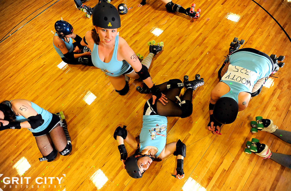 The Bombshell Betties stretch prior to the Battle of Derby Hill roller derby bout against the G I Janes April 30 at AFC Arena on JBLM..