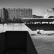 Firminy-Vert, France, Alvernia-Rodano-Alpi, 2016: View of the Sports Stadium (1960), (Left) Saint Pierre Church - Le Corbusier arch - Visit Shop Images to purchase and download a digital file and explore other AS images archive. Photographs by Alejandro Sala