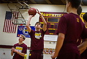 Northfield forward Luke Harris, center, shoots a free throw during warmups before the high school basketball game between Northfield and Rochester Century, Tuesday, December 10, 2013. Harris went on to score 16 points, however the Raiders fell to the Panthers 51-59.
