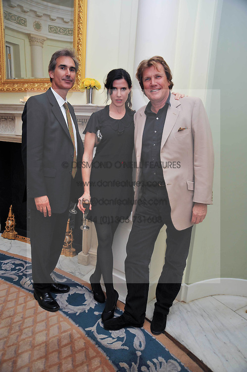 Left to right, DR GERARD HALL, RONNI ANCONA and THEO FENNELL at a party to celebrate the publication of Gosling - Classic Design for Contemporary Interiors by Tim Gosling held at William Kent House, The Ritz Hotel, London on 1st October 2009.