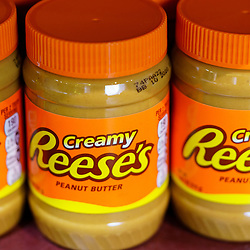 Hershey, PA / USA - November 26, 2019:  Reese's Peanut Creamy Peanut Butter is on display and offered for sale  in Hershey's Chocolate World.