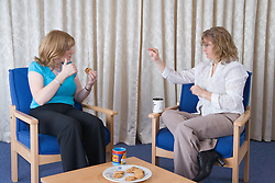 Welfare rights officer and client taking a tea break and signing at The Nottinghamshire Deaf Society,