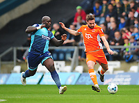 Blackpool's Clark Robertson under pressure from Wycombe Wanderers' Adebayo Akinfenwa<br /> <br /> Photographer Kevin Barnes/CameraSport<br /> <br /> The EFL Sky Bet League Two - Wycombe Wanderers v Blackpool - Saturday 11th March 2017 - Adams Park - Wycombe<br /> <br /> World Copyright © 2017 CameraSport. All rights reserved. 43 Linden Ave. Countesthorpe. Leicester. England. LE8 5PG - Tel: +44 (0) 116 277 4147 - admin@camerasport.com - www.camerasport.com