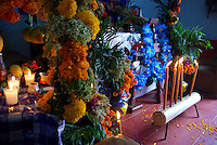 """MEXICO, Veracruz, Tantoyuca, Oct 27- Nov 4, 2009. A pair of altars in Chicontepec, the left dedicated to children. """"Xantolo,"""" the Nahuatl word for """"Santos,"""" or holy, marks a week-long period during which the whole Huasteca region of northern Veracruz state prepares for """"Dia de los Muertos,"""" the Day of the Dead. For children on the nights of October 31st and adults on November 1st, there is costumed dancing in the streets, and a carnival atmosphere, while Mexican families also honor the yearly return of the souls of their relatives at home and in the graveyards, with flower-bedecked altars and the foods their loved ones preferred in life. Photographs for HOY by Jay Dunn."""