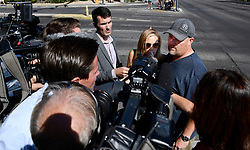 Oct 3,2017. Las Vegas NV.  Scott and Kelly Marrone  from Los Angeles CA, talk to the media Tuesday about 9 of there friends were shot and some died after Sundays mass shooting.  The latest on victims as of Tuesday is still 59 dead, 527 injured last reported Monday night.  The shooting happen during day 3 of the Route 91 Harvest Festival.. Photo by Gene Blevins/ZumaPress. (Credit Image: © Gene Blevins via ZUMA Wire)